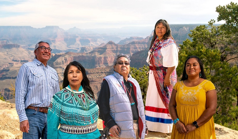 Photo of the Zuni tribal members in front of the Grand Canyon